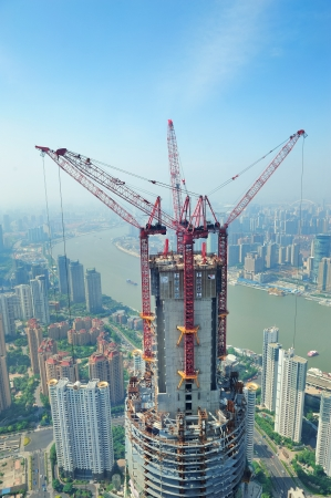 SHANGHAI, CHINA - JUNE 2: Skyscraper under construction on JUNE 2, 2012 in Shanghai, China. Shanghai is the largest city by population in the world with 23 million as in 2010 and is still growing. Stock Photo - 17635403