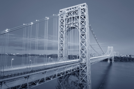 steel arch bridge: George Washington Bridge black and white over Hudson River.