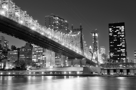 Queensboro Bridge over New York City East River black and white at night with river reflections and midtown Manhattan skyline illuminated. Stock Photo - 18036525