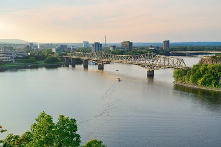alexandra: Alexandra Bridge over river in Ottawa at sunset Stock Photo