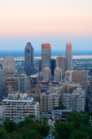 Montreal city skyline at sunset viewed from Mont Royal with urban skyscrapers. Stock Photo