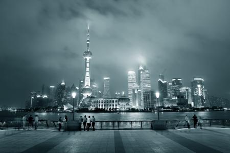 Shanghai urban city skyline over walkway at night in black and white
