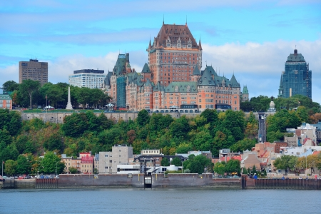 canada: Quebec City skyline over river with blue sky and cloud.