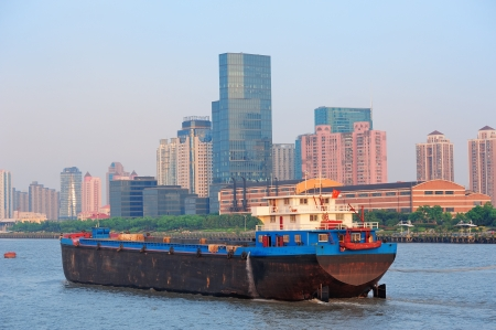 huangpu: Boat in Huangpu River with Shanghai urban architecture Stock Photo