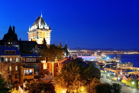 Quebec City skyline with Chateau Frontenac at dusk viewed from hill 免版税图像
