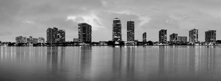 Miami city skyline panorama at dusk with urban skyscrapers over sea with reflection Stock Photo - 18036826