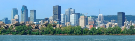 Montreal city skyline panorama over river in the day with urban buildings Stok Fotoğraf