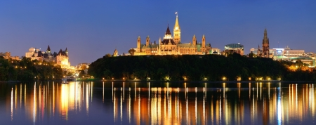 Ottawa at night over river with historical architecture  photo