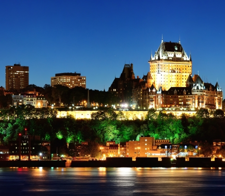 Quebec City skyline at dusk over river viewed from Levis