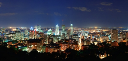 urban scenics: Montreal at dusk panorama with urban skyscrapers viewed from Mont Royal