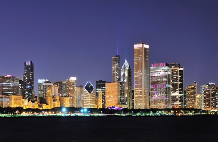 Chicago city downtown urban skyline at dusk with skyscrapers over Lake Michigan with clear blue sky  photo