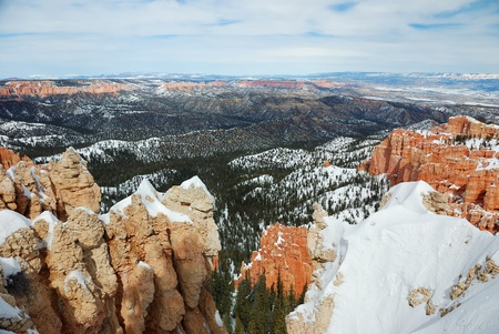 Bryce canyon panorama with snow in Winter with red rocks and blue sky   photo