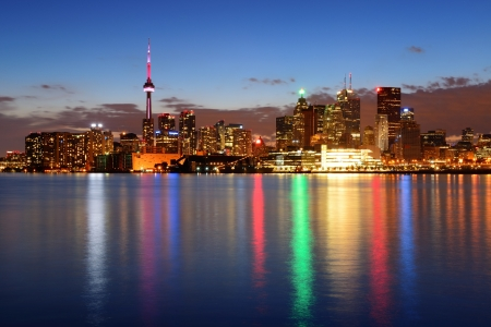 Toronto cityscape panorama at dusk over lake with colorful light. Stock Photo - 18041321