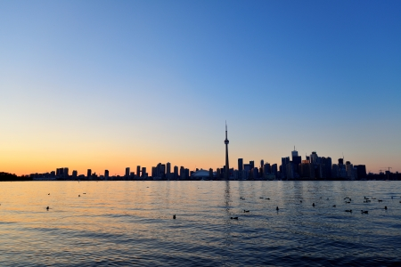 Toronto sunset silhouette at dusk over lake with urban architecture. Stock Photo - 18041739