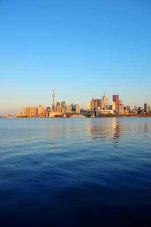 Toronto sunrise with sunlight reflection over lake in the morning Stock Photo - 18041231