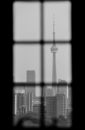 Toronto skyline viewed through window in black and white