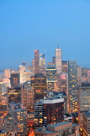Toronto at dusk with city light and urban skyline with skyscrapers photo