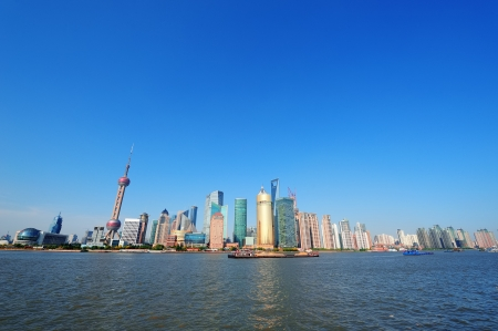 pudong district: Shanghai skyline with skyscrapers and blue clear sky over Huangpu River.