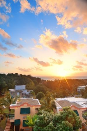 San Juan sunrise with colorful cloud, buildings and beach coastline.  photo