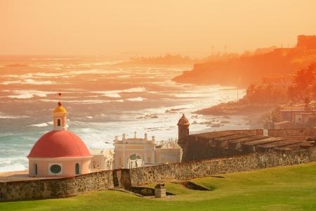 san juan: Old San Juan ocean view with buildings in red tone