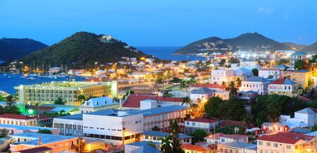 Virgin Islands St Thomas mountain panorama view in early morning with buildings and beach coastline.  photo
