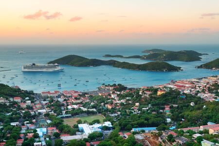 st: Virgin Islands St Thomas sunrise with colorful cloud, buildings and beach coastline