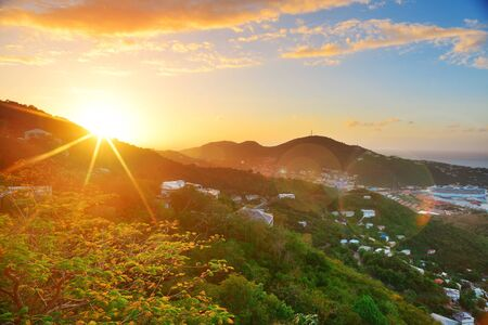 Virgin Islands St Thomas sunrise with colorful cloud, buildings and beach coastline   photo