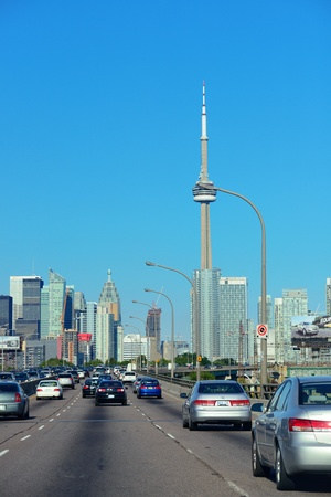 TORONTO, CANADA - JULY 3: Toronto highway with cityscape on July 3, 2012 in Toronto, Canada. Toronto with the population of 6M is the provincial capital of Ontario and the largest city in Canada. Stock Photo - 18613051