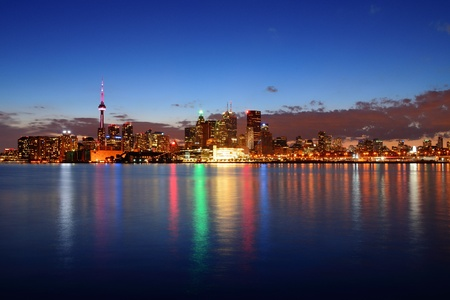 Toronto cityscape panorama at dusk over lake with colorful light. Stock Photo - 18608496