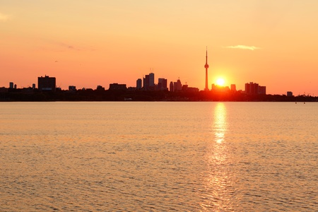 Toronto sunrise silhouette over lake with red tone. Stock Photo - 18608516