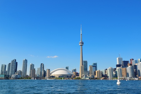 toronto: Toronto skyline panorama over lake with urban architecture.