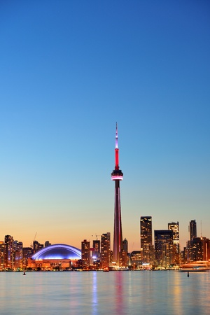 Toronto sunset over lake panorama with urban skyline. Stock Photo - 18613027