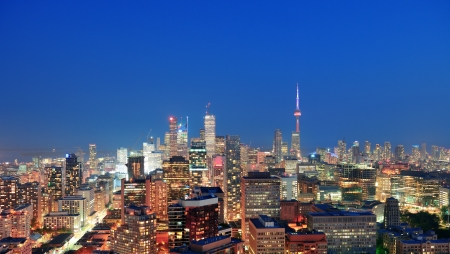 Toronto at dusk with city light and urban skyline with skyscrapers Stok Fotoğraf