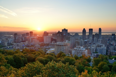viewed: Montreal sunrise viewed from Mont Royal with city skyline in the morning