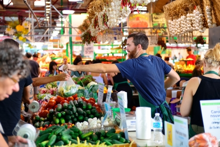 market place: MONTREAL, CANADA - SEP 8: Jean-Talon Market interior on September 8, 2012 in Montreal, Canada. Montreal is the largest in Quebec, the second-largest in Canada and the 15th-largest in North America.