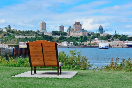 Quebec City skyline over river with blue sky and cloud viewed from park. photo
