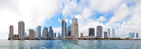 Miami skyline panorama in the day with urban skyscrapers and cloudy sky over sea  photo