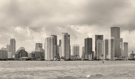 on the black sea: Miami skyline panorama in black and white in the day with urban skyscrapers and cloudy sky over sea