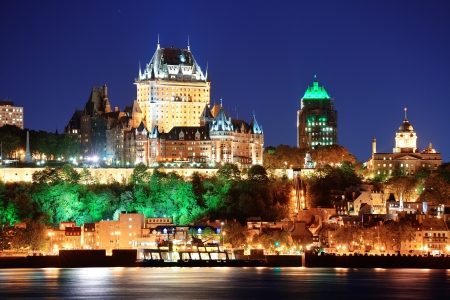 Quebec City skyline at dusk over river viewed from Levis.