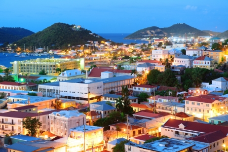 Virgin Islands St Thomas mountain view in early morning with buildings and beach coastline.  photo