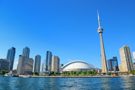Toronto skyline in the day over lake with urban architecture and blue sky photo