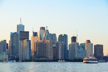 Toronto skyline with boat, urban architecture and blue sky  photo