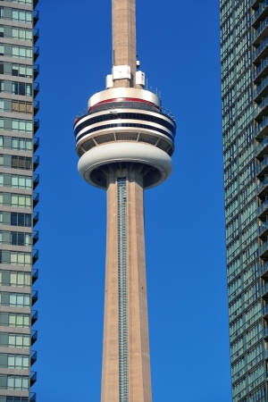 building cn tower: TORONTO, CANADA - JULY 2: CN Tower closeup on July 2, 2012 in Toronto. Buit in 1976 as the unique landmark of Toronto, it was worlds tallest tower for 34 years