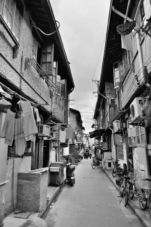 Old street in Shanghai with residential buildings in black and white photo