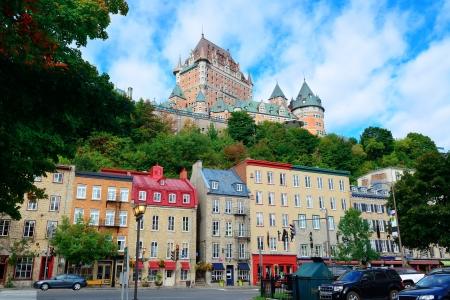 Chateau Frontenac in the day with colorful buildings on street in Quebec City