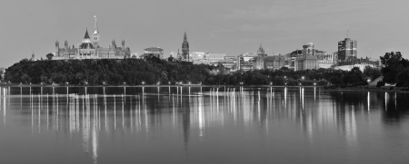 Ottawa at night over river with historical architecture in black and white