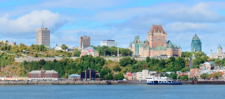 Quebec City skyline panorama over river with blue sky and cloud.