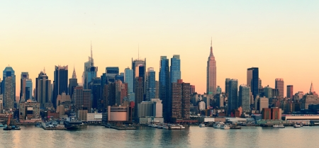 new york city times square: New York City midtown Manhattan sunset skyline panorama view over Hudson River