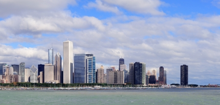 Chicago skyline panorama with skyscrapers over Lake Michigan with cloudy blue sky. photo