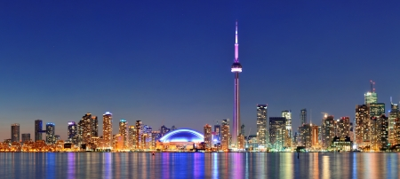building cn tower: Toronto cityscape panorama at dusk over lake with colorful light. Stock Photo